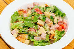 Salad with cheese, ham and fresh vegetables Royalty Free Stock Photography