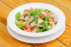 Salad with cheese, ham and fresh vegetables Royalty Free Stock Images