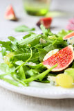 Salad with cheese, rocket salad and grapes Royalty Free Stock Image