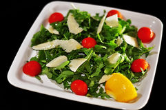 Salad with cheese and tomatoes Stock Image