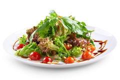 Salad with cherry and pine nuts Stock Image