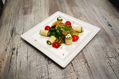 Salad with cherry tomatoes, cucumbers and meat on table Stock Photo