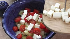 Salad with cherry tomatoes and goat cheese stock footage