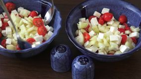 Salad with cherry tomatoes and goat cheese stock video