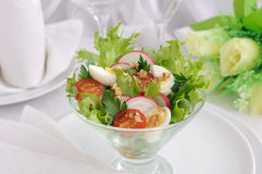 Salad of summer vegetables with quail eggs Stock Image
