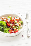Salad with cherry tomatoes and soft cheese on a vintage plate Royalty Free Stock Photo