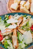 Salad with chicken breast, parmesan cheese, croutons, tomatoes, mixed greens, lettuce and glass of wine Royalty Free Stock Photos