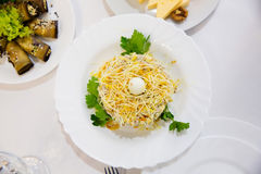 Salad with chicken and cheese on restaurant table Royalty Free Stock Images