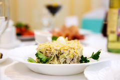 Salad with chicken and cheese on restaurant table Royalty Free Stock Image