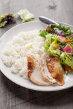 Salad with chicken on dark wood. Italian salad with rotisserie chicken and white rice on dark wood Royalty Free Stock Photography