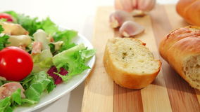 Salad with chicken and garlic bread stock footage