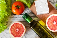 Salad with chicken, grapefruit, cheese and tomatoes royalty free stock image