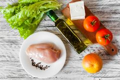 Salad with chicken, grapefruit, cheese and tomatoes stock images