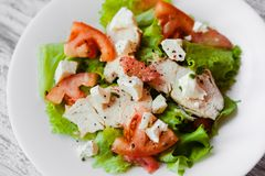 Salad with chicken, grapefruit, cheese and tomatoes royalty free stock photography