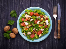 Salad with chicken and grapefruit. Selective focus Royalty Free Stock Photo