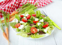 Salad with chicken liver. cherry tomatoes and feta cheese.  Royalty Free Stock Image