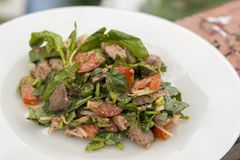 Salad with chicken liver. Delicious hot salad in the open air Royalty Free Stock Image