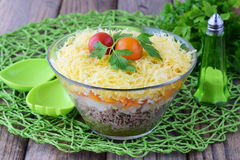 Salad with chicken liver in layers with pickles,boiled carrot, egg, cheese in a glass bowl on a black abstract Stock Images