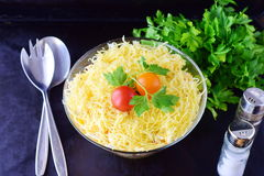 Salad with chicken liver in layers with pickles,boiled carrot, egg, cheese in a glass bowl on a black abstract Royalty Free Stock Photo