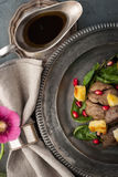 Salad with chicken liver and spinach  on the vintage plate with napkin Royalty Free Stock Photo