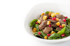 Salad with chicken liver and spinach in the white plate Royalty Free Stock Photos