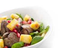 Salad with chicken liver and spinach in the white plate horizontal Stock Photography