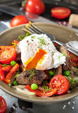 Salad with chicken livers, vegetables and poached egg Royalty Free Stock Photo