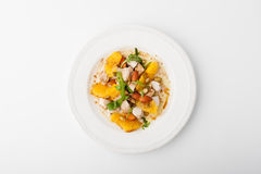 Salad with chicken, orange, arugula and pumpkin seeds Stock Photos