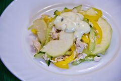 Salad with chicken and pear on a white plate Stock Photo