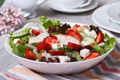 Salad with chicken, strawberries and vegetables close up. On the table. horizontal Stock Photography
