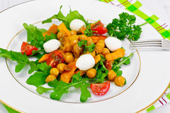 Salad with Chickpeas in a Curry Sauce, Arugula, Grilled Pumpkin Royalty Free Stock Photos