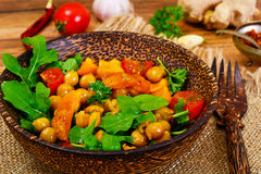 Salad with Chickpeas in a Curry Sauce, Arugula, Grilled Pumpkin Stock Photography