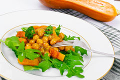 Salad with Chickpeas in a Curry Sauce, Arugula, Grilled Pumpkin Royalty Free Stock Image