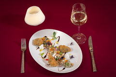 Salad with chickpeas and fish with onions and peppers with seeds ginger fetta cheese. PLATE IN WHITE FOR RESTAURANT stock photo