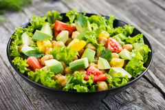 Salad with chickpeas, tomato and avocado Royalty Free Stock Photo