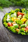 Salad with chickpeas, tomato and avocado Stock Image