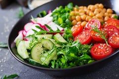 Salad of chickpeas, tomatoes, cucumbers, radish and greens. Dietary food. Buddha bowl. Vegan salad Royalty Free Stock Photography