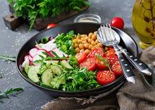Salad of chickpeas, tomatoes, cucumbers, radish and greens. Dietary food. Vegan salad Royalty Free Stock Photos