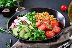 Salad of chickpeas, tomatoes, cucumbers, radish and greens. Dietary food. Vegan salad Stock Photography