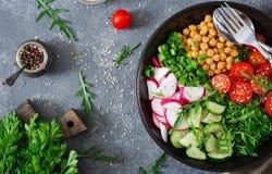 Salad of chickpeas, tomatoes, cucumbers, radish and greens. Dietary food. Vegan salad. Top view. Flat lay. Buddha bowl Royalty Free Stock Photography