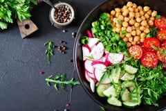 Salad of chickpeas, tomatoes, cucumbers, radish and greens. Dietary food. Vegan salad. Top view. Flat lay. Buddha bowl Stock Photography