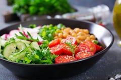 Salad of chickpeas, tomatoes, cucumbers, radish and greens. Dietary food. Buddha bowl. Vegan salad Royalty Free Stock Image