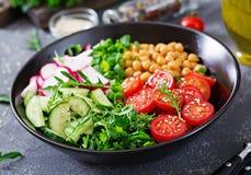 Salad of chickpeas, tomatoes, cucumbers, radish and greens. Dietary food. Buddha bowl. Vegan salad Royalty Free Stock Photos