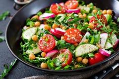 Salad of chickpeas, tomatoes, cucumbers, radish and greens. Dietary food. Vegan salad Royalty Free Stock Image