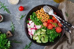Salad of chickpeas, tomatoes, cucumbers, radish and greens. Dietary food. Vegan salad. Top view. Flat lay Royalty Free Stock Photography