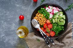 Salad of chickpeas, tomatoes, cucumbers, radish and greens. Dietary food. Vegan salad. Top view. Flat lay. Buddha bowl Stock Images