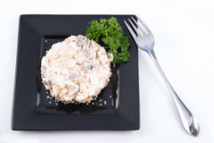 Salad with chiken, mushrooms and mayonnaise. Decorated by parsley on white background Royalty Free Stock Photos