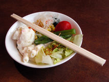 Salad and chopsticks royalty free stock photography