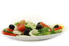 Salad close-up. On the white background Stock Images