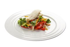 Salad with cod. Traditional Latvian dish. On a white background stock photography